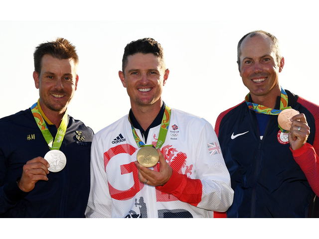 RIO DE JANEIRO, BRAZIL - AUGUST 14:  Justin Rose (C) of Great Britain celebrates with the gold medal, Henrik Stenson (L) of Sweden, silver medal, and Matt Kuchar of the United States, bronze medal, after the final round of men's golf on Day 9 of the Rio 2016 Olympic Games at the Olympic Golf Course on August 14, 2016 in Rio de Janeiro, Brazil.  (Photo by Ross Kinnaird/Getty Images)